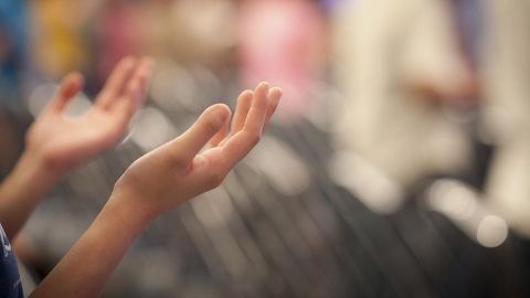 hands-raised-worship_480_270_s_c1